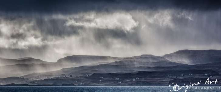 Rain over the hills on Isle of Skye Scotland